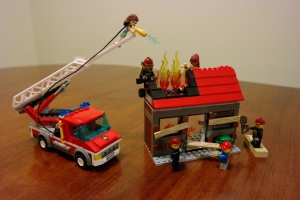 LEGO fire being put out by team